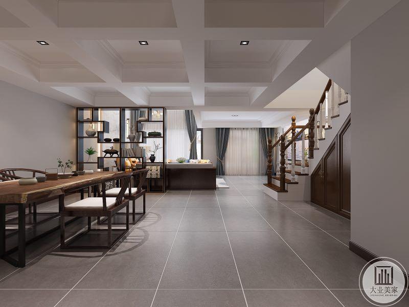 负二层休闲区:在家具的选择上,选择了现在大家比较喜欢的布艺材质,和部分的皮质沙发相结合。在沙发的选择上确不是单纯的布艺,而是布艺和木质的结合,深色的木质的外结构和布艺完美结合,保留了中式家具的厚重和温馨感,也很好的保证了使用的舒服性。